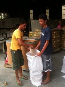 Workers Packing Soy Meals for Further Distribution